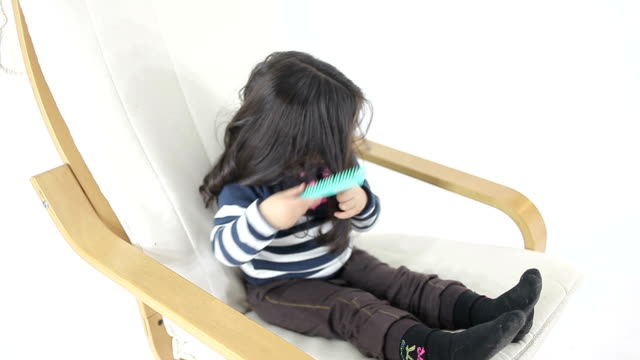 hd:little cute girl combing hair - personal hygiene product stock videos & royalty-free footage