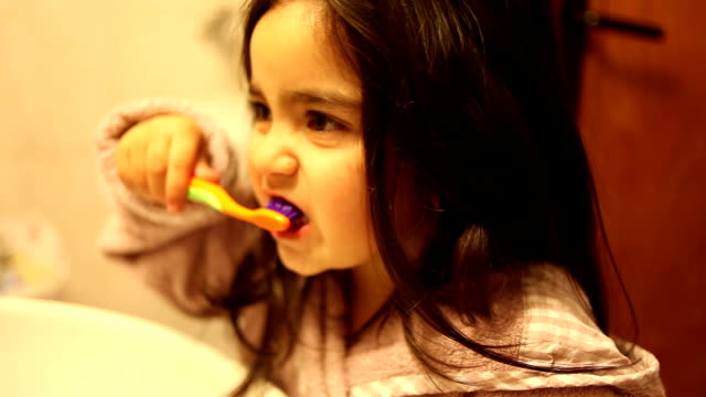 HD:Little Girl Brushing Her Teeth