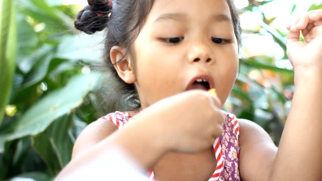 HD:Little girl eating French fries at the fastfood