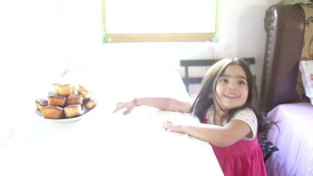 hd:little girl &eating &muffin - reaching stock videos & royalty-free footage