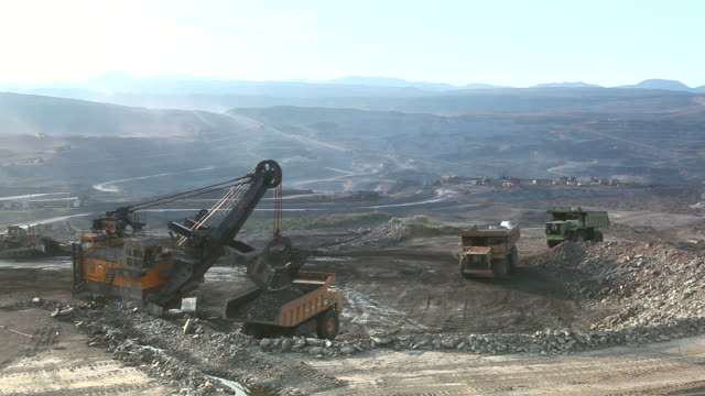 hd:loading of iron ore on very big dump-body truck. - iron ore stock videos & royalty-free footage