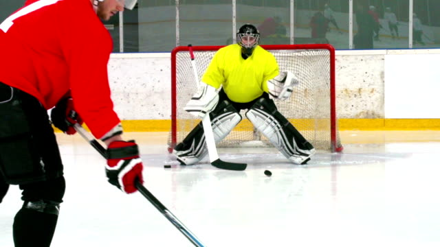 hd:m.s.shot of hockey player shooting at goal - hockey glove stock videos & royalty-free footage
