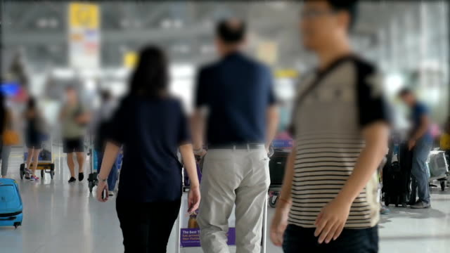 HD:Passenger and traveller walking in departure terminal at airport , slow motion and blurred concept