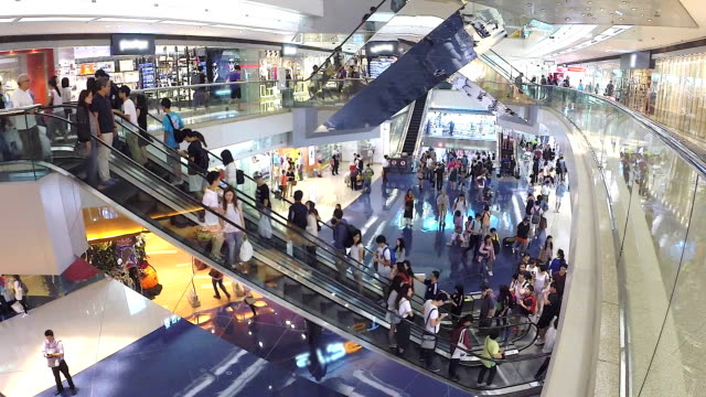 hd:people moving on escalator in shopping mall.(timelapse) - shopping centre stock videos & royalty-free footage