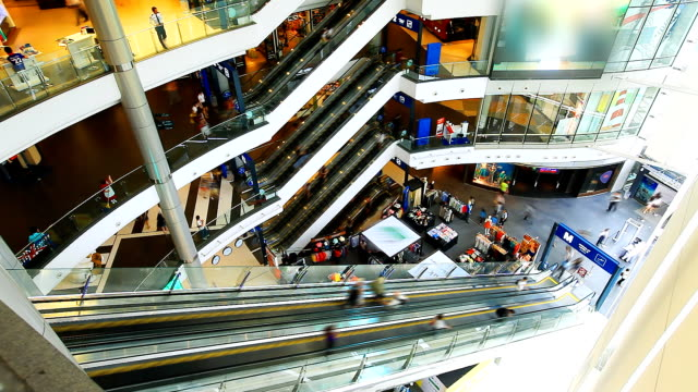 hd:people moving on escalator in shopping mall.(timelapse) - department store stock videos and b-roll footage
