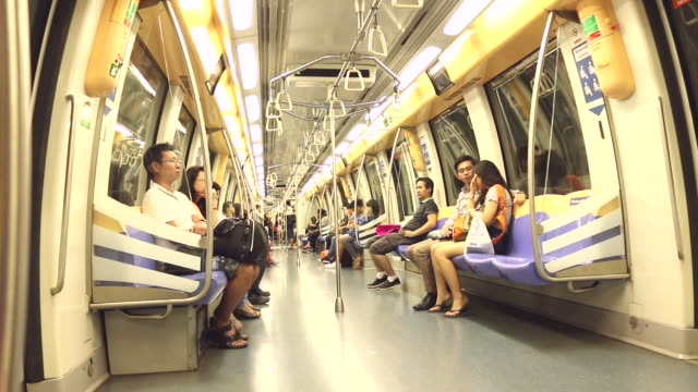HD:People sitting on underground train.