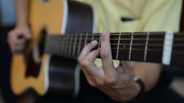 hd:playing acoustic guitar - fretboard stock videos and b-roll footage