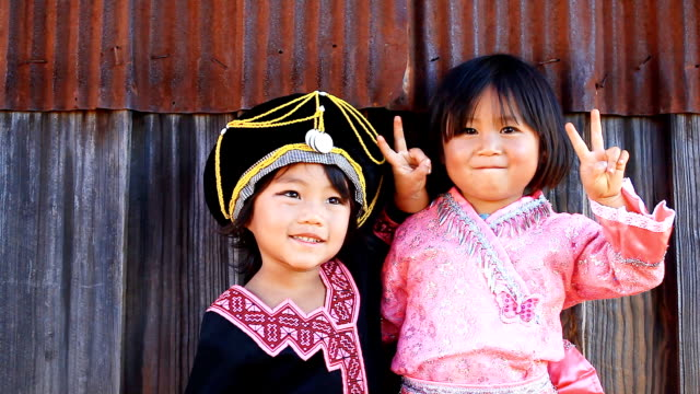 HD:Portrait of two girls with traditional dress.