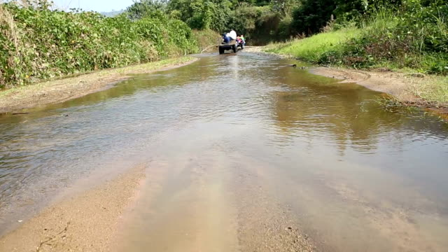 hd:quadbike off road over river - quadbike stock videos & royalty-free footage