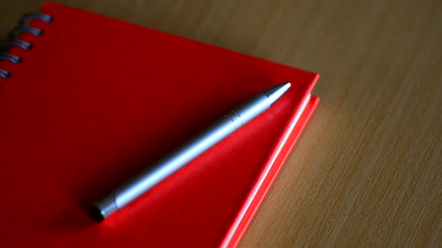 hd:red notebook on the table - netbook stock videos and b-roll footage