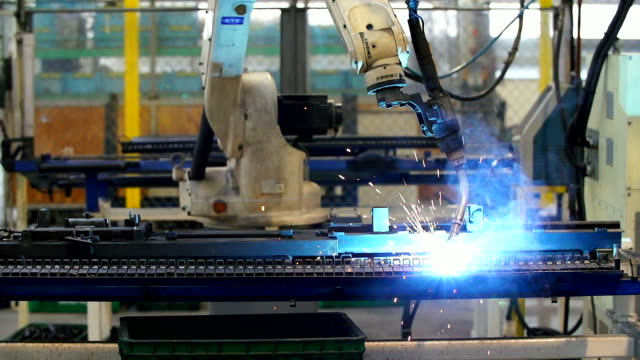 HD:Robot arm welding in a factory.(Slow motion)