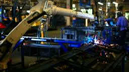 HD:Robot arm welding machine working in factories.