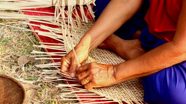 hd:senior hands manually weaving bamboo basket. - woven stock videos & royalty-free footage
