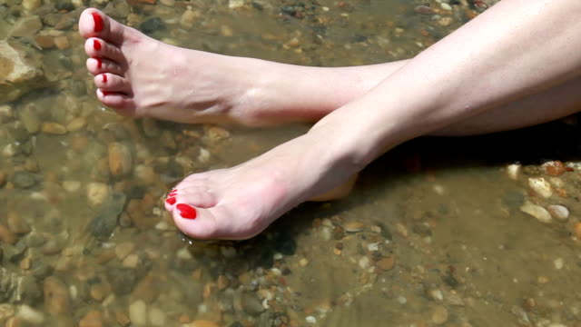 hd:sexy feet - legs crossed at ankle stock videos and b-roll footage