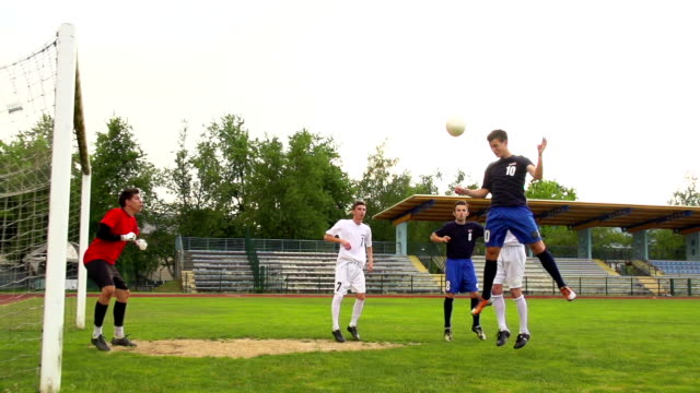hd:shot of soccer players at scoring action - defender soccer player stock videos and b-roll footage