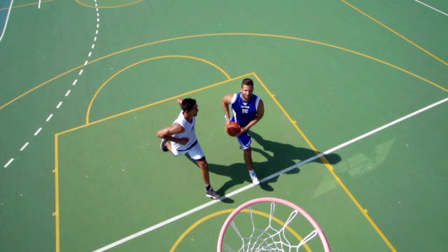 hd:slo-mo shot of two young players doing jump-shot and block - basketball stock videos and b-roll footage