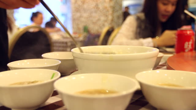 hd:soup serving a ladle at chinese restaurant. - ladle stock videos & royalty-free footage
