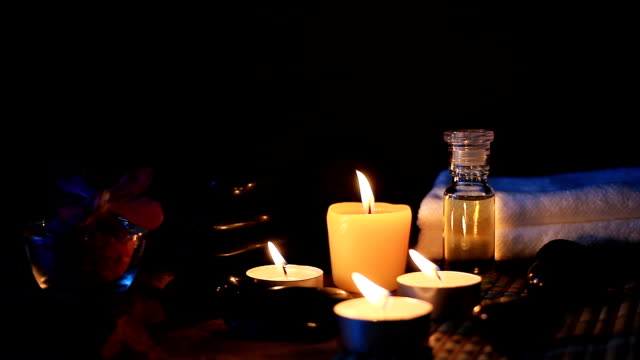 HD:Spa still life of zen stone, candle and massage oil