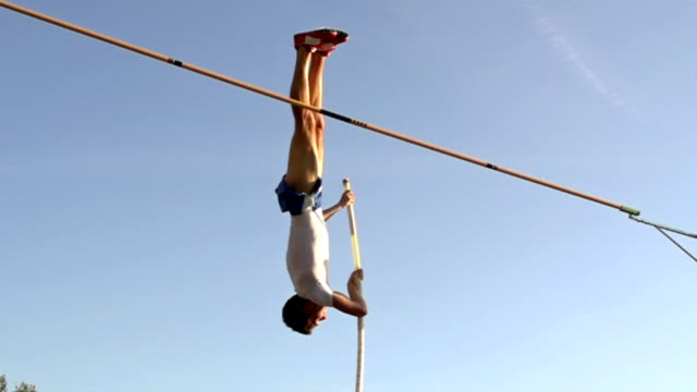 hd:super slo-mo shot of young athlete at pole vault - pole stock videos & royalty-free footage