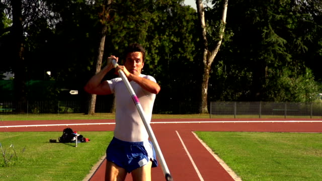 hd:super slo-mo shot of young athlete performing at pole vault - pole stock videos and b-roll footage
