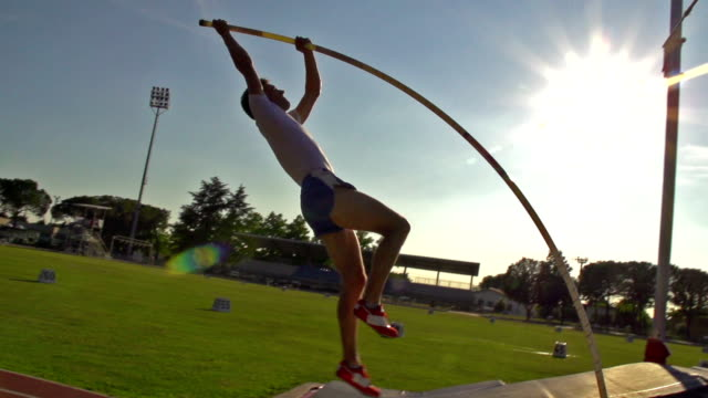 hd:super slo-mo shot of young man at pole vault - sportsperson stock videos & royalty-free footage