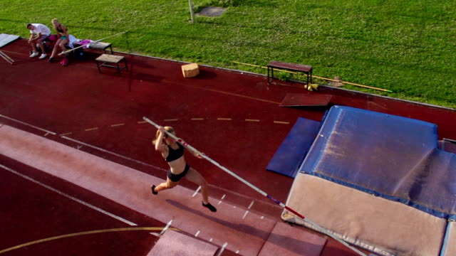 hd:super slo-mo shot of young women at pole vault - pole stock videos and b-roll footage