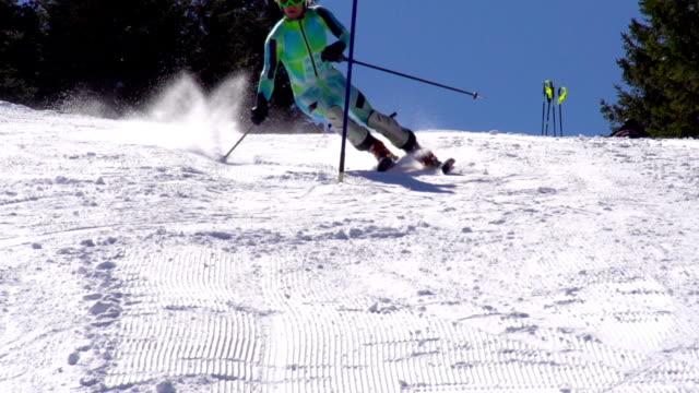 hd:super-slo-mo: professional skier practicing slalom - slalom skiing stock videos & royalty-free footage