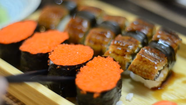 hd:sushi japanese food eating - toro fish stock videos and b-roll footage