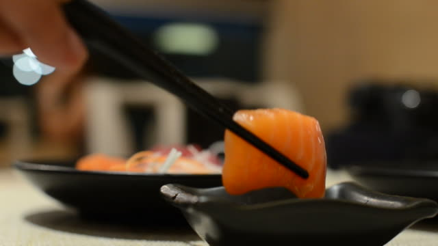 hd:sushi japanese food eating - wasabi sauce stock videos and b-roll footage