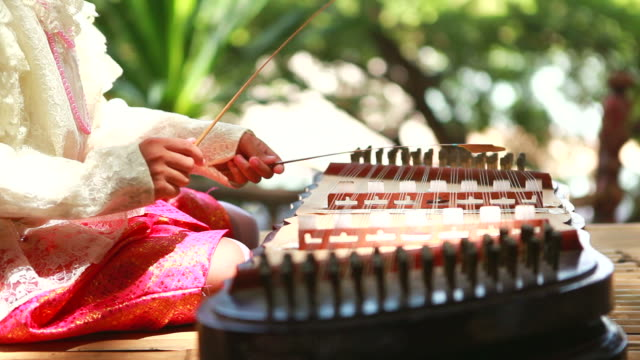 HD:Thai Instrument playing by thai girl.