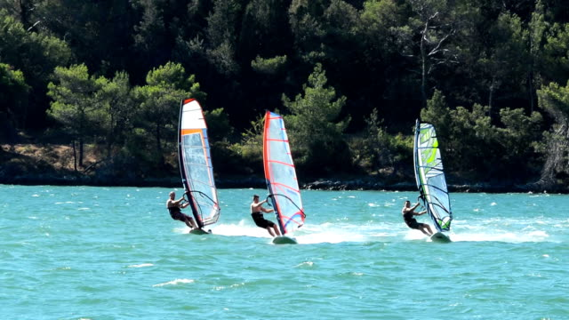 HD:Three male windsurfers in the action