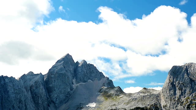 hd:timelapse of julian alps showing jalovec - julian alps stock videos and b-roll footage