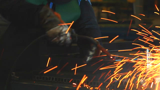HD:Worker using welding machine on his work.