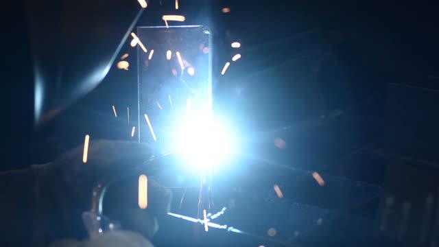 HD:Worker welding metal