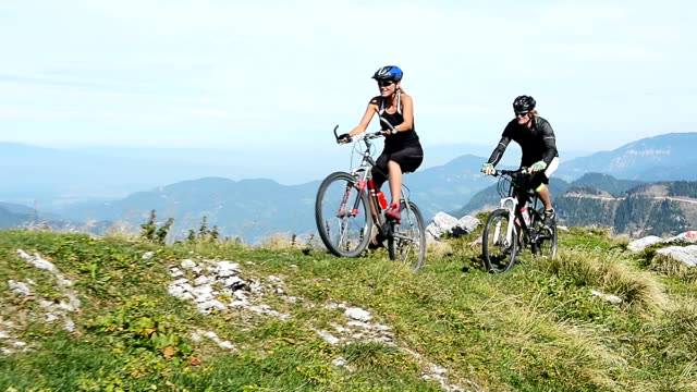 hd:young couple reaching the mountain peak - mountain biking stock videos & royalty-free footage