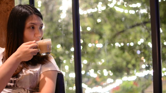 HD:Young girl relax in coffee cafe