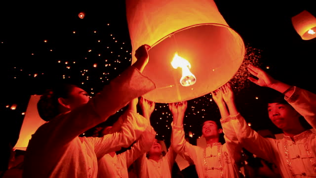 hd:young people release floating lanterns to the sky. - indigenous culture stock videos & royalty-free footage