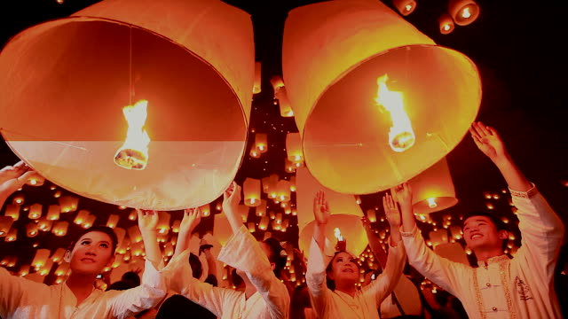 hd:young people release floating lanterns to the sky. - releasing stock videos and b-roll footage