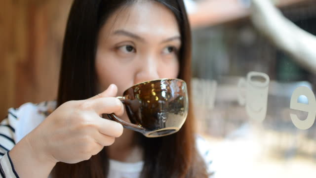 HD:Young woman drinking coffee for break time