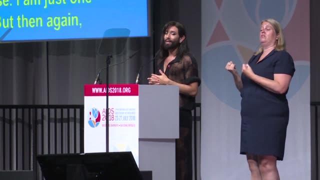 he 22nd international aids conference kicks off in amsterdam with an opening speech by austrian drag queen conchita wurst - aids bildbanksvideor och videomaterial från bakom kulisserna