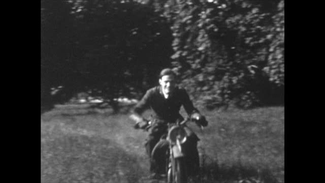 he is riding around a small field past haystacks, with a house in the background. home movie shot at a house near muckamore, co. antrim, northern... - young men stock videos & royalty-free footage