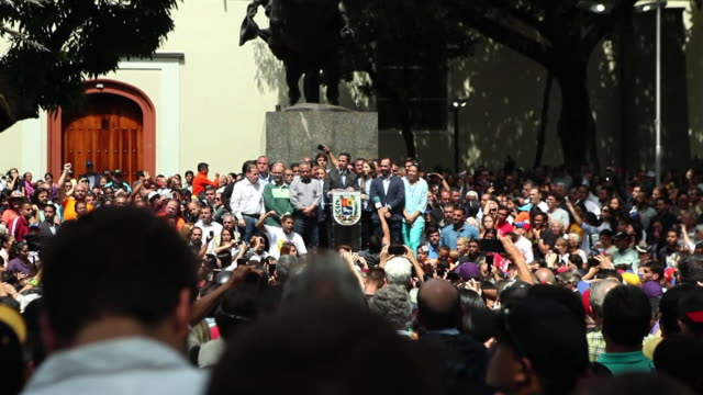he is the man recognised as president by many outside his country - but a fugitive in its capital.today juan guaido came out of hiding to speak to... - venezuela stock videos & royalty-free footage