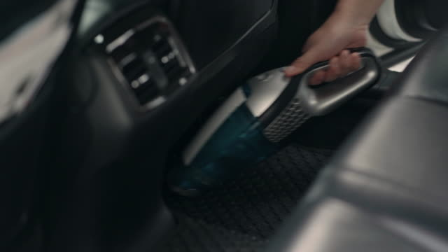 he is using a vacuum cleaner inside of the car. - vacuum cleaner stock videos & royalty-free footage