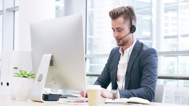 he manages inbound and outbound calls in a timely manner - headset stock videos & royalty-free footage