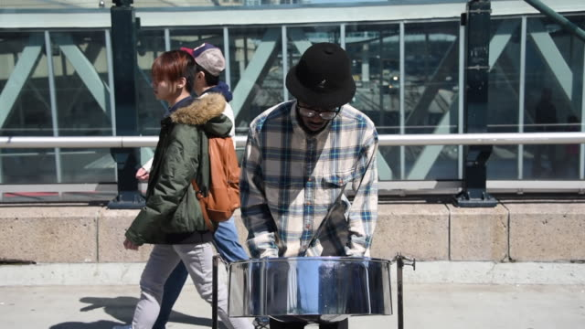 he plays traditional music of his country of origin toronto attracts many tourists due to its variety of cultures which have brought music and food... - afro caribbean ethnicity stock videos and b-roll footage