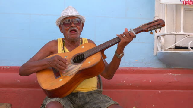 He throws the guitar in the air and then continues playing Trinidad is a Unesco World Heritage Site and famous tourist attraction in the Caribbean...