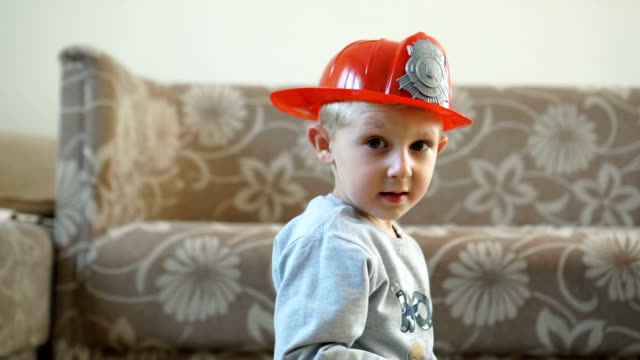 he wants to be a fireman when he grows up - children only video stock e b–roll