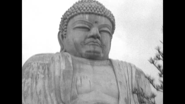 head and shoulders of the giant buddha statue / note: exact month/day not known - religion stock videos & royalty-free footage