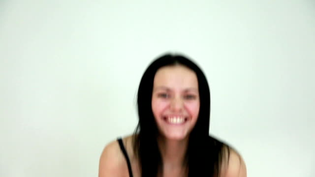 head and shoulders portrait of a happy woman smiling with toothy smile over gray background - human teeth stock videos and b-roll footage