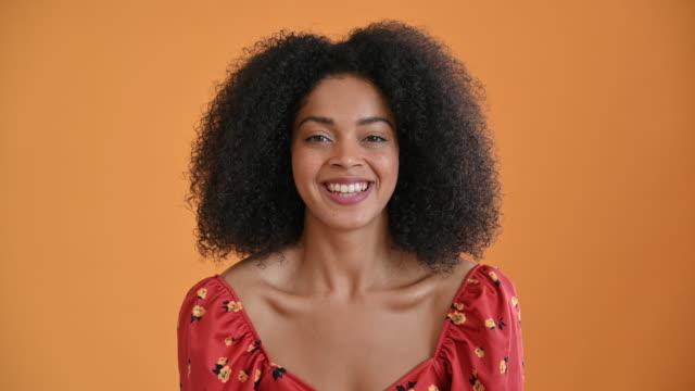 head and shoulders view of cheerful young mixed race woman - medium length hair stock videos & royalty-free footage